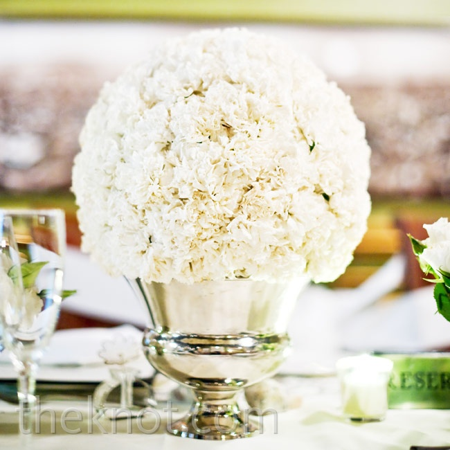 White arrangements in silver vases brightened the restaurant's richly decorated private room.