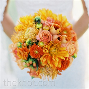 Lia's textured orange bouquet incorporated all of the types of flowers her bridesmaids carried individually.