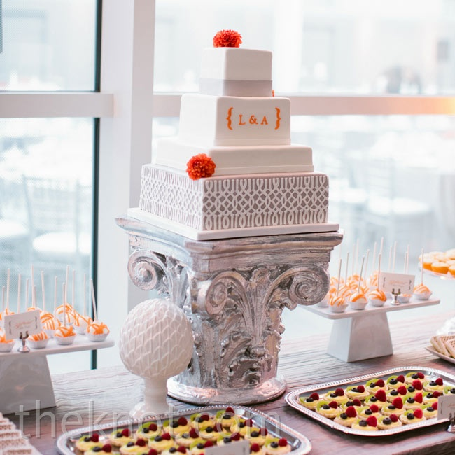 The highlight of the dessert table was the ultra-modern four-tiered cake, complete with the couple's monogram.
