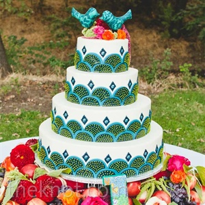 More fresh fruit, along with flower petals, was displayed with the elaborate teal cake.