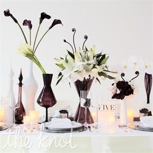 Plum orchid and white table decor