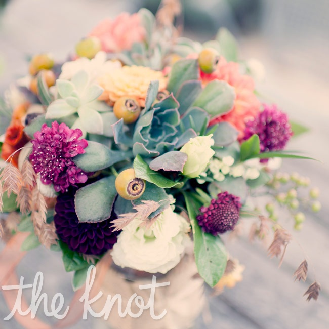 Incorporating all the colors of the wedding palette, Catherine carried a loose bunch of dahlias, scabiosa, succulents, strawflowers, sage, rosemary, and berries.