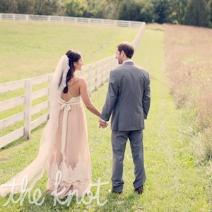 Catherine was drawn to the warmth of her blush tulle gown, and Mike's gray suit blended right in.