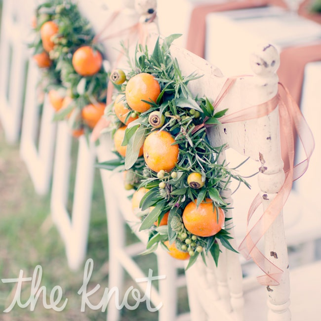 Small wreaths of herbs and orange indicated the couple's place at the table. The rustic chairs came from a thrift store, and Catherine and Mike now use them in their kitchen!