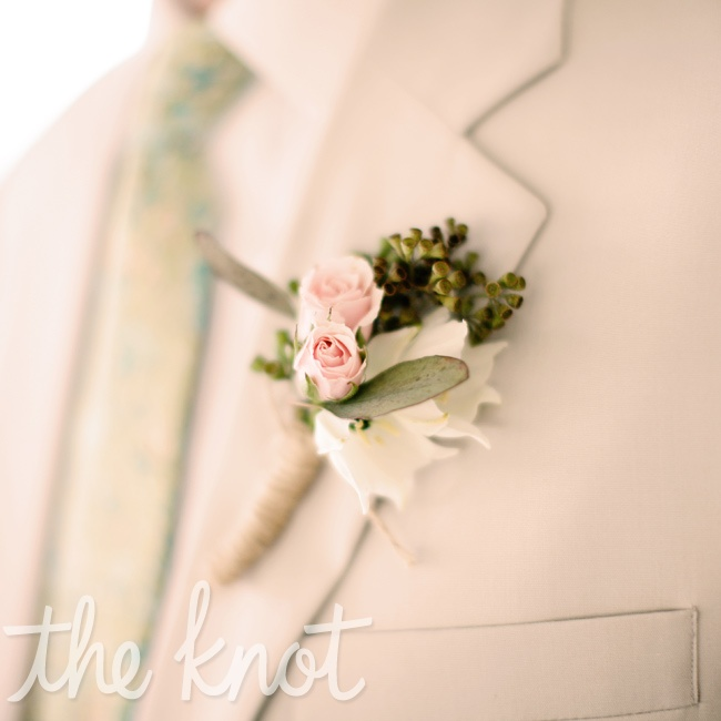 Pink spray roses and an ivory cabbage rose bloom blended well with the guys' pastel ties (custom-made from Liberty London fabric).