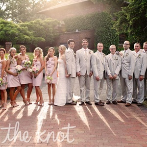 To play up the outdoor garden aesthetic, the bridal party coordinated in flirty pink cocktail dresses and stone-colored suits.