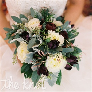 Cool, wintery greens like eucalyptus and lamb's ears were mixed with ivory roses for a seasonal bouquet.