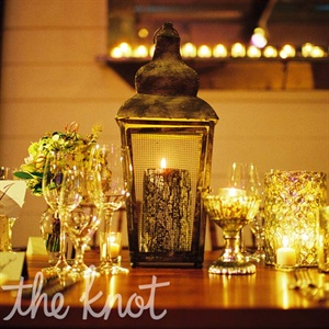 Since candlelight led the theme of the evening, the tables were adorned with votives and pillars of varying heights, some displayed in rustic lanterns.