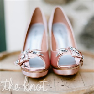 Jillian's romantic pink satin peep-toe heels tied in with the other vintage-style elements of her day-of look.