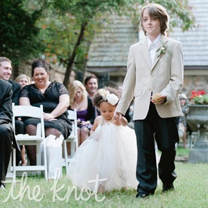 Since the flower girl was only 18 months old at the time, she simply held the hand of her older brother, the ring bearer.