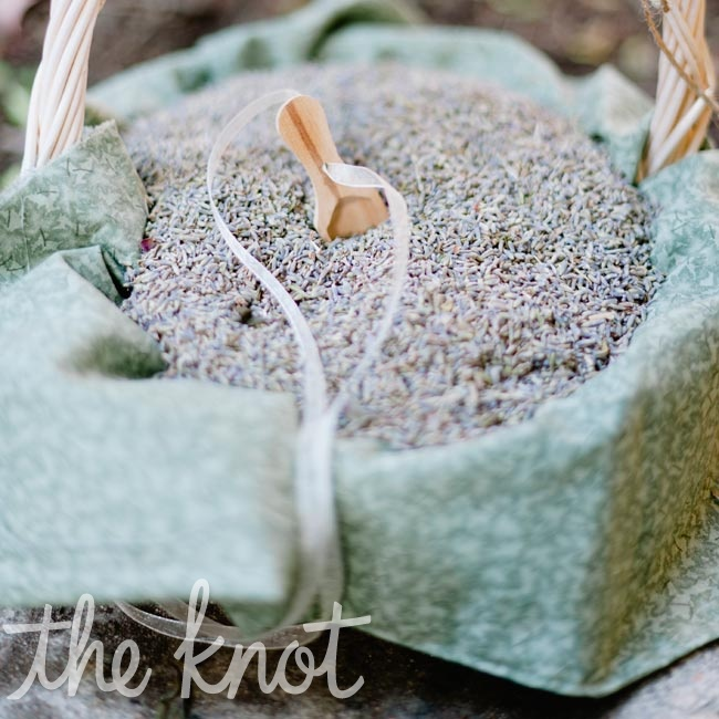During the ceremony, a basket of loose lavender was passed around so that the guests could shower the newly married couple as they walked back up the aisle.