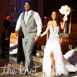 When it came to the day's fashion, the couple was all about bespoke: Chris had his personal tailor create a gray tuxedo for him, and Monique worked directly with Pnina Tornai on a bejeweled gown.