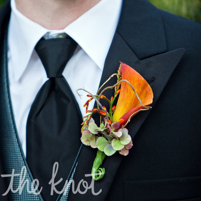 Orange calla lilies were dressed up with elements from the girls' bouquets.