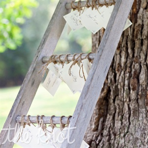 Simple cards were tied with twine and hung from a quaint garden ladder.