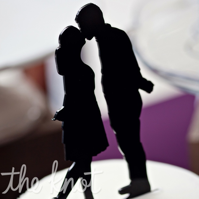 Personalized silhouettes of the couple topped the small cutting cake.
