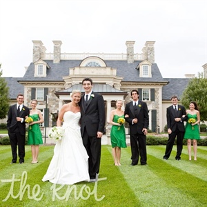 The bridesmaids' rich green dresses stood out against the guys' classic black tuxes.