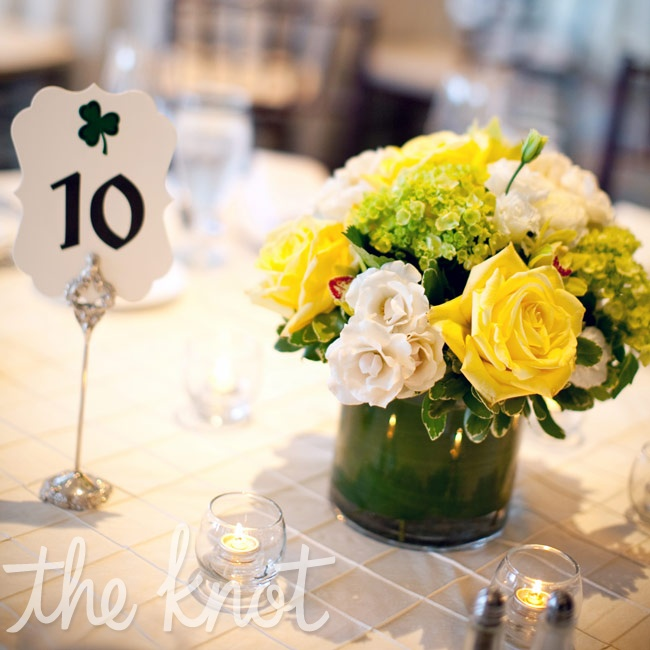 For a fun touch, the couple included shamrock designs in their table numbers.