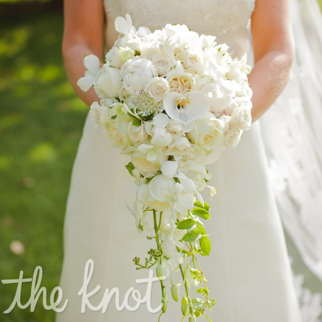Sarah incorporated orchids into her all-white bouquet, since that's what her mother had carried at her own wedding.