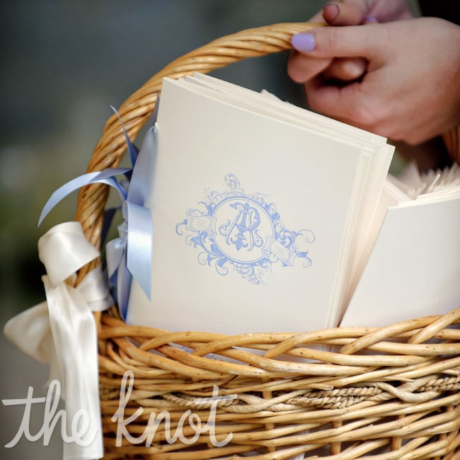 Classic booklets printed with a blue monogram and tied with ribbon held the ceremony details.