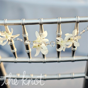 A string of orchids was an understated way to mark Annie's and Patrick's chairs.