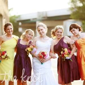 "In keeping with Jessica and Scott's ""color"" wedding theme, each bridesmaid wore a unique dress in a different solid hue."