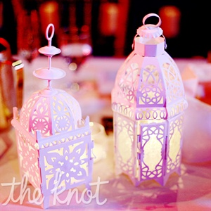 Intricate white lanterns holding tea lights gave a cozy glow to each of the dinner tables.
