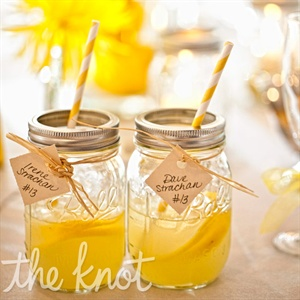 Vodka lemonade served in Mason jars played off the casual vibe of the day and doubled as escort cards (names and table numbers were tied on).