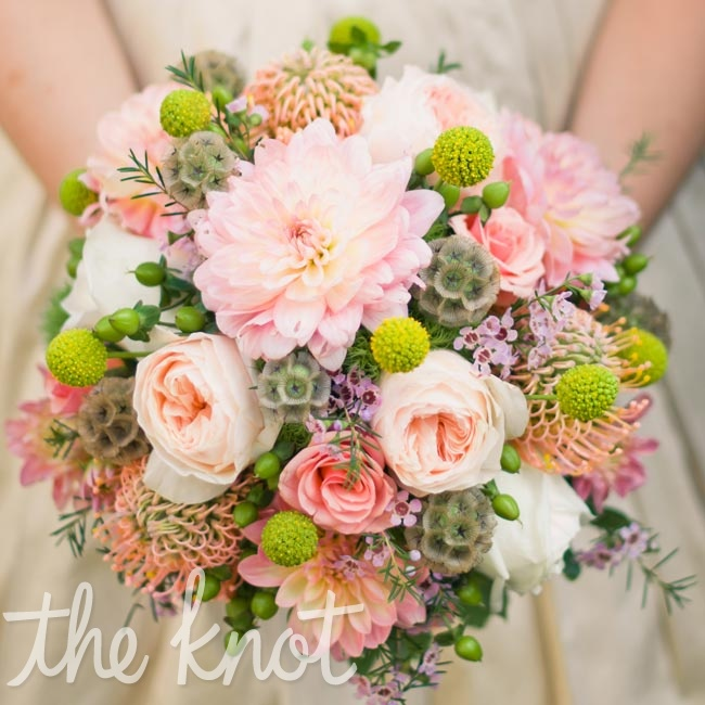 Laura held a burst of eclectic colors and flowers, like pink dahlias and scabiosa pods.