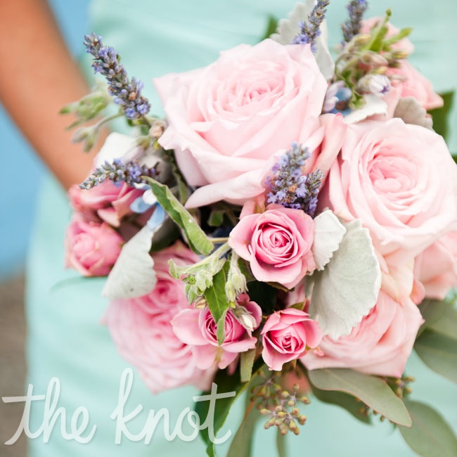 The bridesmaids carried pink spray roses, dusty miller and astilbe.