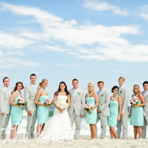 The bridesmaids wore mint dresses, while the guys matched the beachy look in light-gray suits.