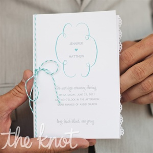 Classic white ceremony programs were tied with aqua-and-white baker's twine for a touch of color.