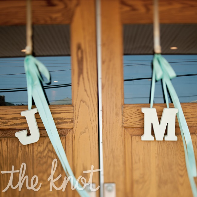 For a personal touch, the couple's initials hug form the church doors.