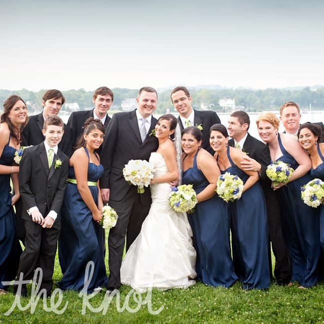 The bridesmaids wore matching navy floor-length dresses, while the guys coordinated in suits and lime-green ties.
