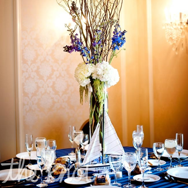 Sky-high arrangements of hydrangeas, orchids, green amaranthus, and curly willow topped the tables.