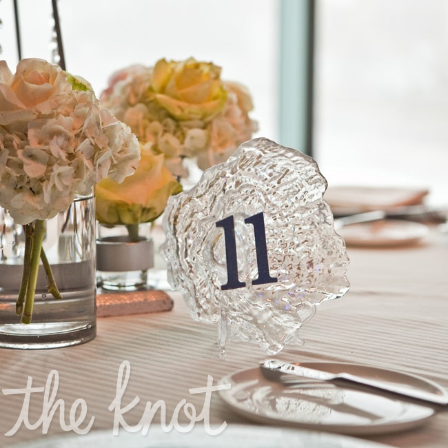Glass oyster shells labeled with navy numbers marked the tables.