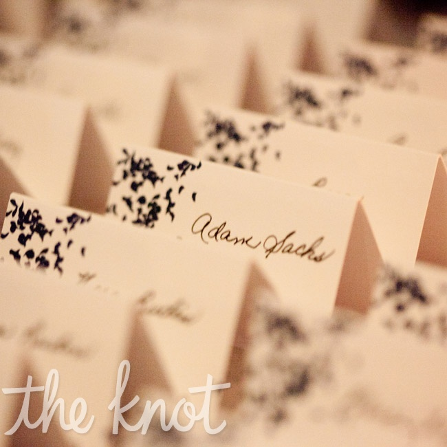 Simple white tented escort cards featured a navy design.