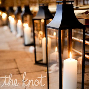 Black lanterns with pillar candles lined the ceremony aisle.