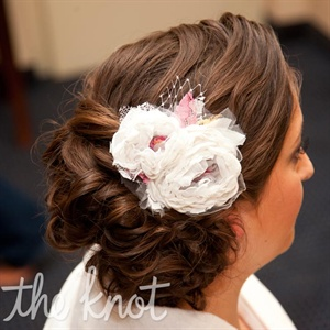Sarah wore a custom-made fabric-flower hairpiece.