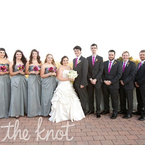 The bridesmaids matched in gray floor-length dresses, while the guys' plum ties (that Sarah's mom made!) followed the day's palette.