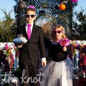 The flower girl and ring bearer looked stylish in a tutu and a gray suit accessorized with oversize sunglasses.