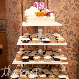 Instead of a cake, the couple went with vegan cupcakes and displayed them on a stand that Sarah's father made.