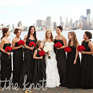 The bridesmaids all chose their own black floor-length evening gowns.