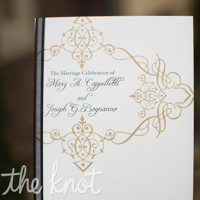 An elegant gold design decorated the ivory linen paper ceremony programs.