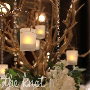 Votive candles and crystals hung from manzanita branches on some reception tables.