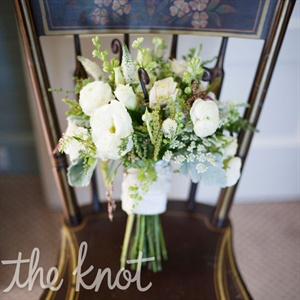 Lara carried a white bunch of lisianthus, ranunculus, and fiddlehead ferns.