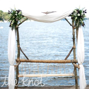A friend of the couple made their wooden arbor-he even included a bench so they could use it after the wedding.