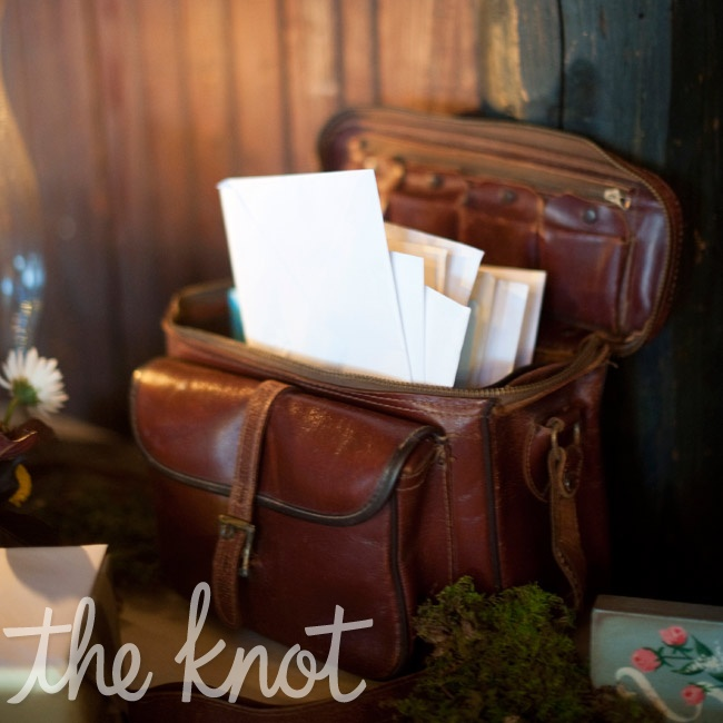 Guests put their wedding cards in an old leather camera bag-a nod to Lara's photography roots.