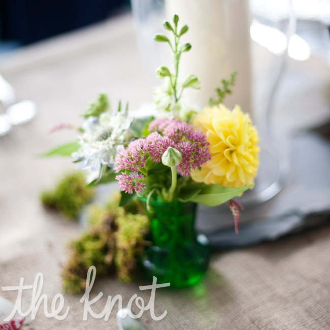 White, yellow, and pink blooms filled jars and vases on reception tables to create a just-picked look.