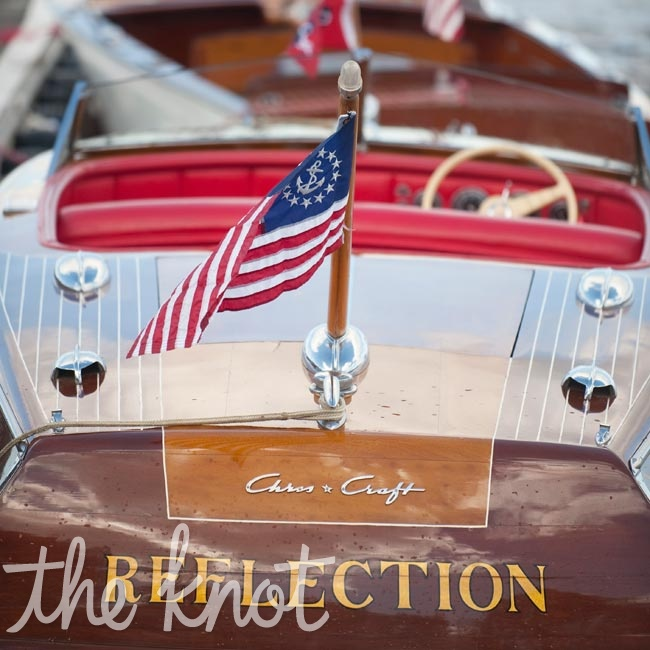 The bridal party and the newlyweds rode to the ceremony in these old-fashioned wooden boats.