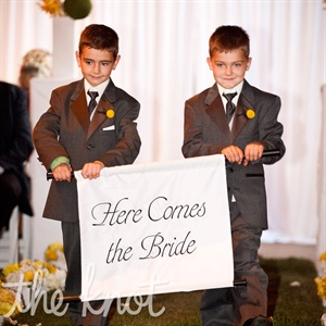 Brenda&#39;s nephews announced her ceremony arrival with a sign.